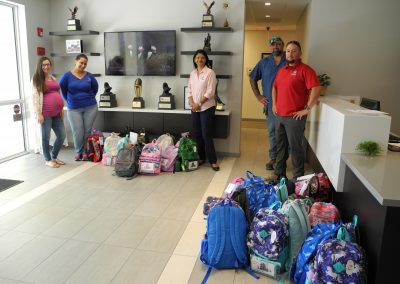 LCF employees helping with 4KIDS Back to School Drive collecting back packs
