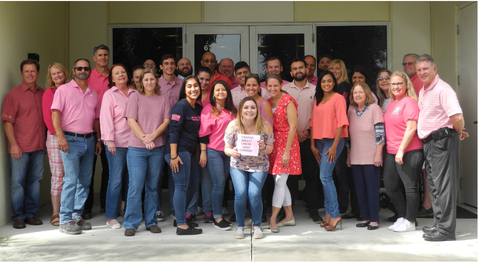Breast Cancer Awareness Month office staff wearing pink to show support